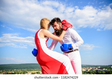 Defend your opinion in confrontation. Man and woman fight boxing gloves sky background. Female attack. Take course to be confident in safety. Pursue course of self defence. Attack is best defence.