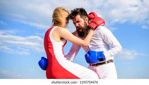 Defend your opinion in confrontation. Man and woman fight boxing gloves sky background. Attack is best defence. Female attack. Take course to be confident in safety. Pursue course of self defence.