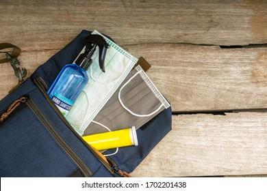 """Defense against Covid-19"" starter pack. Surgical masks, hand sanitizer, vitamin falling out of bag. Corona virus prevention pack. Ear loop Medical mask. New normal starter pack."