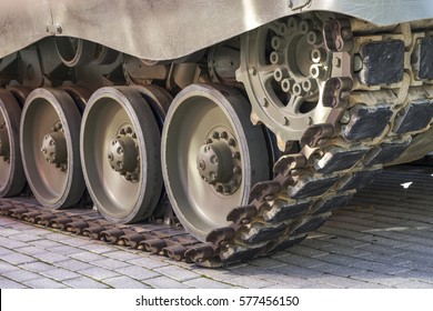 Defense, Military tank, detail of tracks or wheels of the off-road armored vehicle