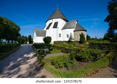 Defensive round church in Osterlars, Bornholm, Denmark. It is one of four round churches on the Bornholm island. Built about 1150, regarded the oldest round church