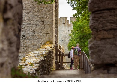 The defensive wall of Visby, Gotland in Sweden. The strongest and best preserved medieval city wall in Scandinavia. Beautiful view on wooden bridge through stone window for overwatching, embrasure.