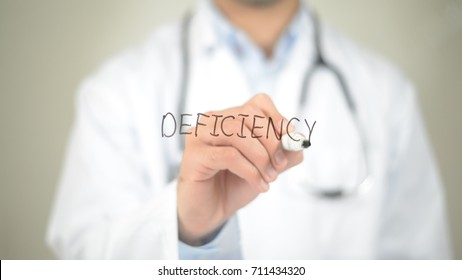 Deficiency , Doctor writing on transparent screen