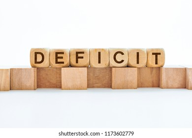 Deficit word on wooden cubes