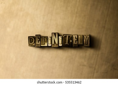 DEFINITELY - close-up of grungy vintage typeset word on metal backdrop. Royalty free stock illustration.  Can be used for online banner ads and direct mail.