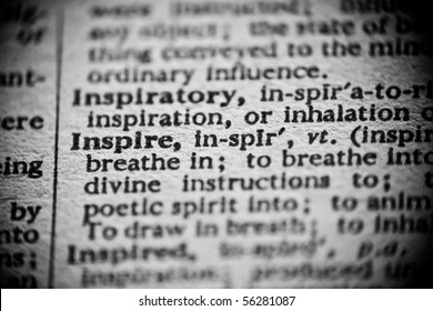 The definition of 'Inspire' is highlighted in an old dictionary.