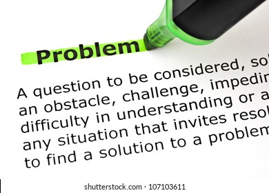Definition of the word Problem highlighted with green marker on white paper.