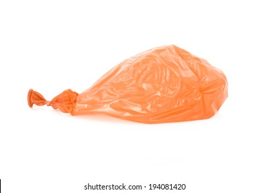 Deflated orange balloon isolated over white background