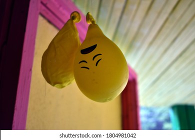 deflated yellow balloons hang from the ceiling