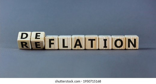 Deflation or reflation symbol. Turned cubes and changed the word deflation to reflation. Beautiful grey background, copy space. Business, deflation or reflation concept.