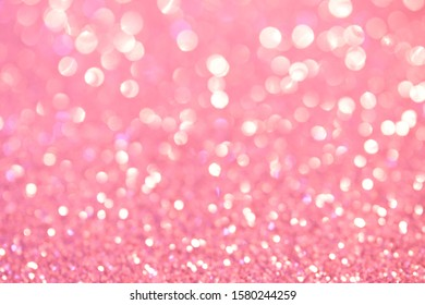 Defocus abstract show. Soft pink holiday lights. Bright background and backdrop. Magic.