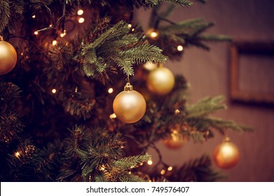 Defocus beautiful dark background. decorations on a Christmas tree and glare of lights