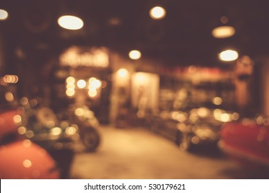 defocus or blur image of retro car and motorcycle, effect by vintage style