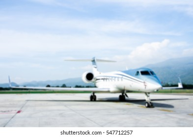 Defocus or Blur of Small Airplane or Aeroplane Parked at Airport.Small Airplane Famous to use Private Airplane.Mountain View.