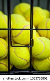 Defocus image of Close up view of balls in basket on clay tennis court. Focus on balls