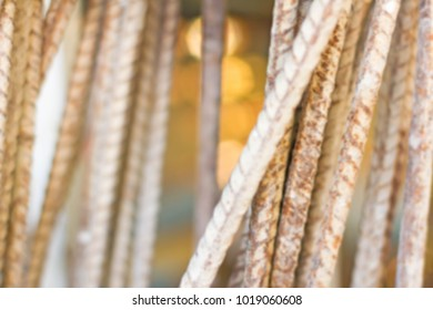 Defocus of old white steel bars with bokeh in orange and copy space.