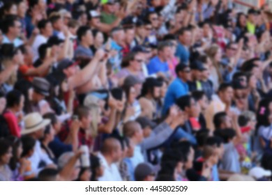 Defocus picture of crowd watching a show