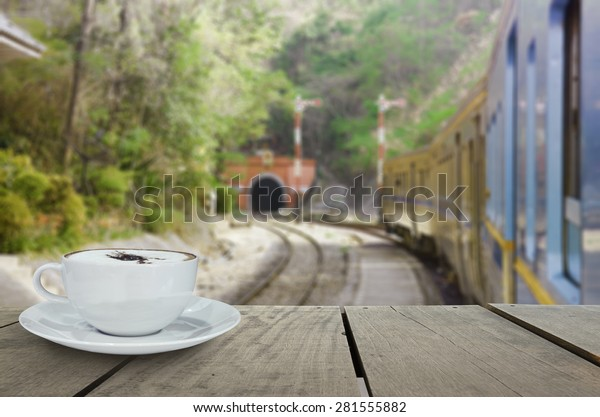 Defocus with terrace wood and cappuccino coffee with train into tunnel for background usage