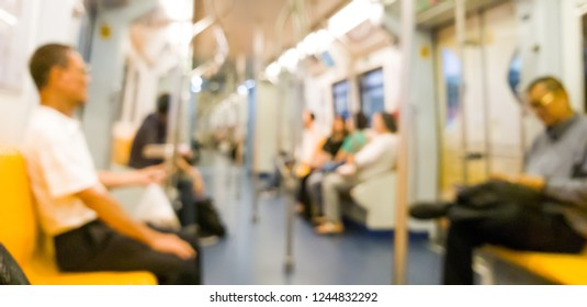 Defocus view of people is on the bts skytrain in Thailand-blurred motion background.Blurred of people sitting on subway.