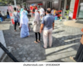 defocused abstract background of people queuing for medical tests