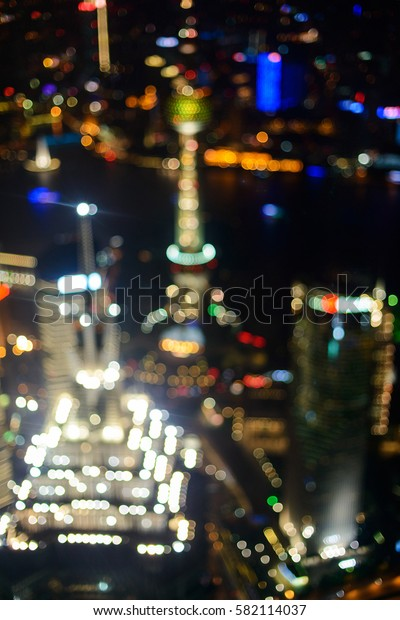 Defocused abstract elevated night shot of Shanghais skyline, with Jin Mao Tower and Oriental Pearl Tower.