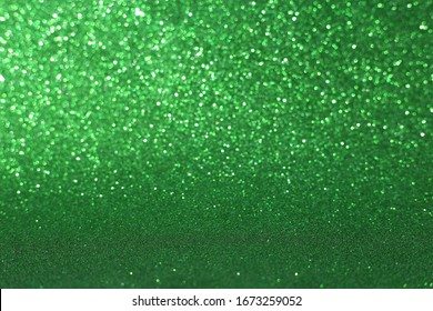 Defocused abstract green lights background. Space. Wallpaper. Abstract glitter bokeh