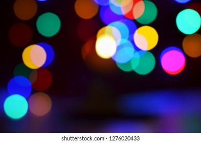 defocused abstract light bokeh background in the night city, dark background