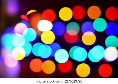 defocused abstract light bokeh background in the night city, blurred dark background