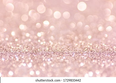 Defocused abstract pink twinkle light background.  Pink glittery bright shimmering background use as a design backdrop.