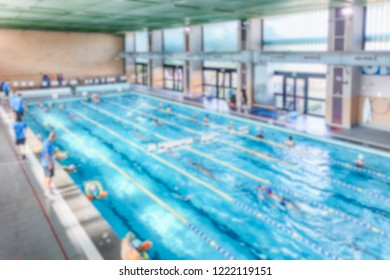Defocused background with aerial view of a swimming pool indoor. Intentionally blurred post production for bokeh effect