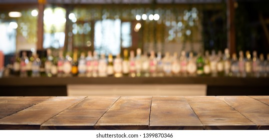 Defocused background and bottles of restaurant, bar or cafeteria background. Using for Mock up template for craft display of your design,Banner for advertise of product.