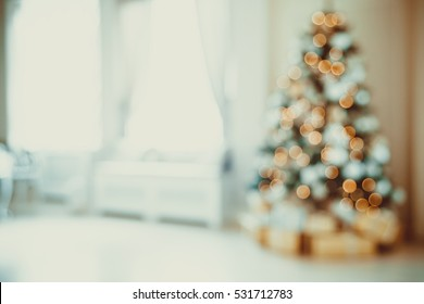 Defocused background Christmas Living room with christmas tree.