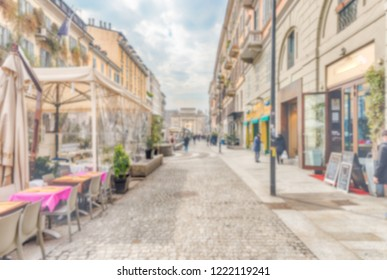 Defocused background of Corso Como, iconic pedestrian street and heart of the nightlife scene in Milan, Italy. Intentionally blurred post production for bokeh effect