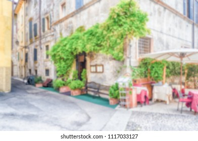 Defocused background with historical buildings in  Verona, Italy. Intentionally blurred post production for bokeh effect