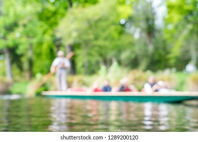 Defocused background impressionist scene of tourists being punted along Avon River in Christchurch New Zealand