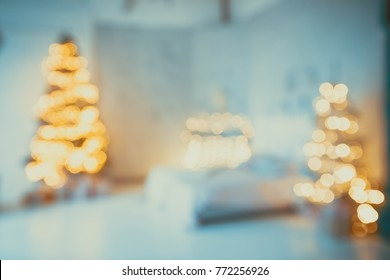 Defocused background Living room with christmas tree. Beautiful New Year decorated classic home interior. Winter background