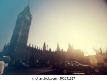 Defocused background of London traffic near Big Ben of Westminster in rush hour.