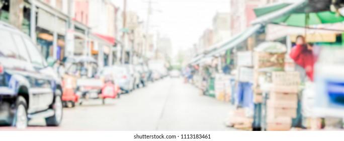 Defocused background of Philadelphia's 9th street Italian Market. Intentionally blurred post production for bokeh effect