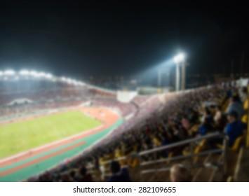 defocused background of soccer or football stadium at twilight,Thailand