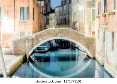 Defocused background with view at night over a scenic canal, Venice, Italy. Intentionally blurred for bokeh effect