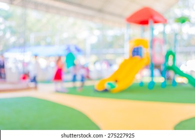 Defocused and blur image of children's playground at public park for background usage.