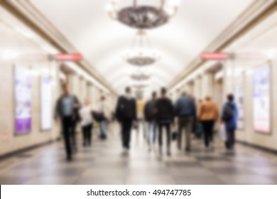 Defocused blur of people traveling in underground wagon - Metro transportation concept. People getting off the subway train. Motion blur. City life.