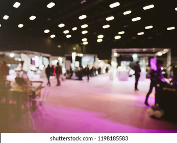 Defocused blur view of wedding exhibition with people silhouettes consulting new offers