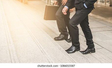defocused or blured Businessman walking the stairs with city background, Businessmen go to success concept, vintage style.