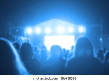 De-focused / blurred concert crowd enjoying the music.