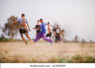 Defocused and blurred image for background of kids are playing soccer football.