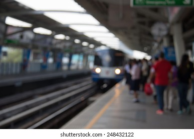 Defocused and blurred image for background of people rush hour on skytrain