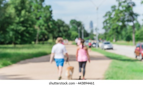 Defocused, blurred motion background of summer activities with energetic people jogging, walking, running and bicycling at green city park. Urban outdoor workout. Healthy lifestyle concept. Panorama.