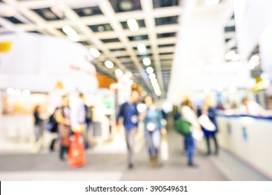 Defocused bokeh abstract of generic trade show expo stand - Concept of business social gathering for international tradeshow of tourism meeting exchange - Soft overexposed desaturated filter