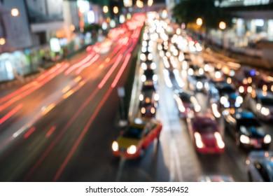 Defocused or bokeh light image of night traffic in city